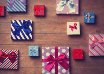 Different color gift boxes on wooden background